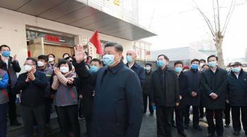 Gobierno de China reanuda actividades en medio de la epidemia de coronavirus; el presidente usa cubrebocas