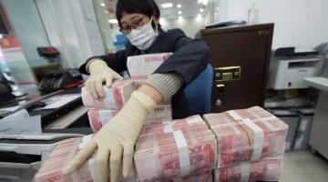 Para evitar más contagios de Covid-19, China pone en cuarentena sus billetes