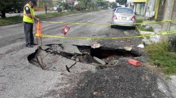 Reporta PEC formación de tres socavones en Villahermosa, por las lluvias